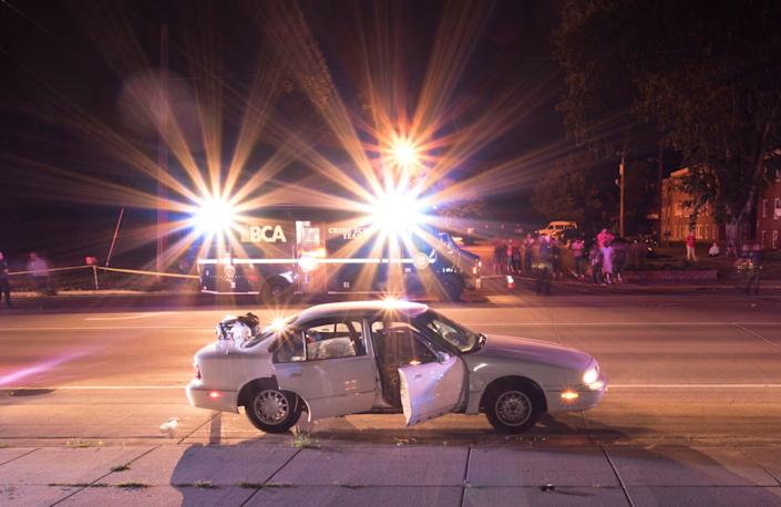 The car of Philando Castile is seen surrounded by police vehicles in an evidence photo taken after he was fatally shot by St. Anthony Police Department officer Jeronimo Yanez during a traffic stop in July 2016.