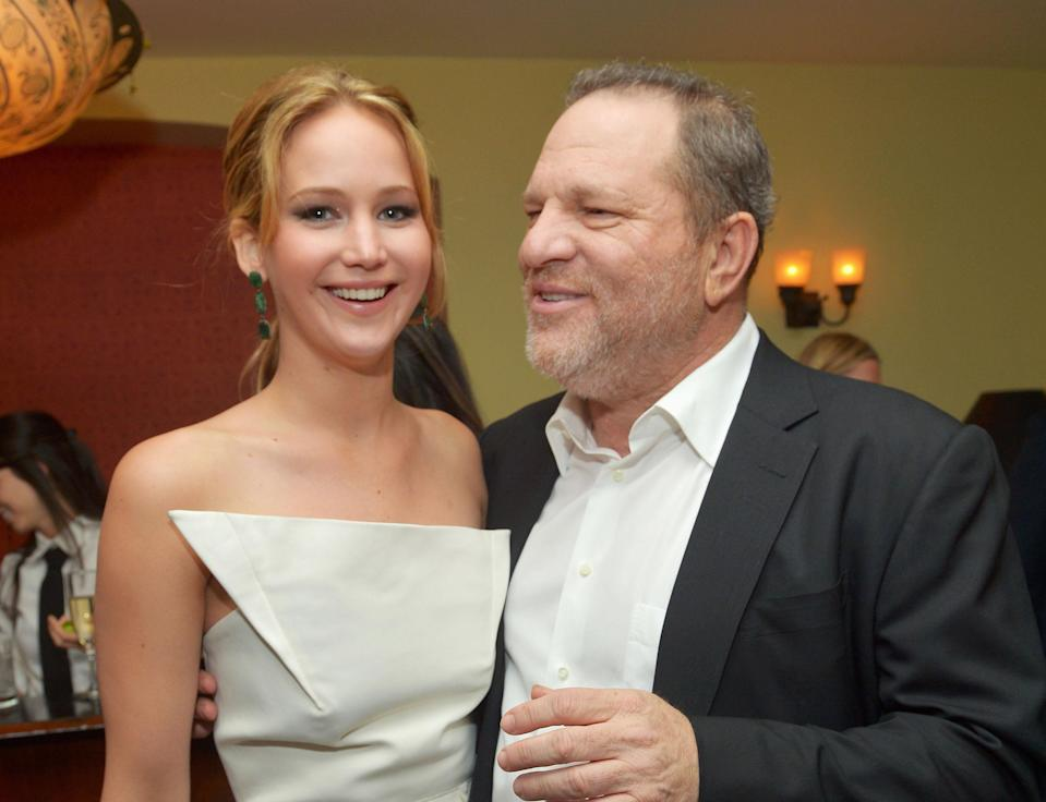 Jennifer Lawrence and Harvey Weinstein at a 2013 screening of <em>Silver Linings Playbook</em>. (Photo: Charley Gallay/Getty Images for VF)