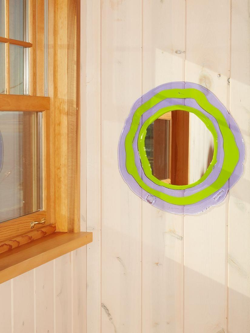 <p>It may be the color combination or the quirky shape, this <span>Round Mirror</span> ($255) sparks joy. Give your visitors something to look at by hanging it above your entryway table.</p>
