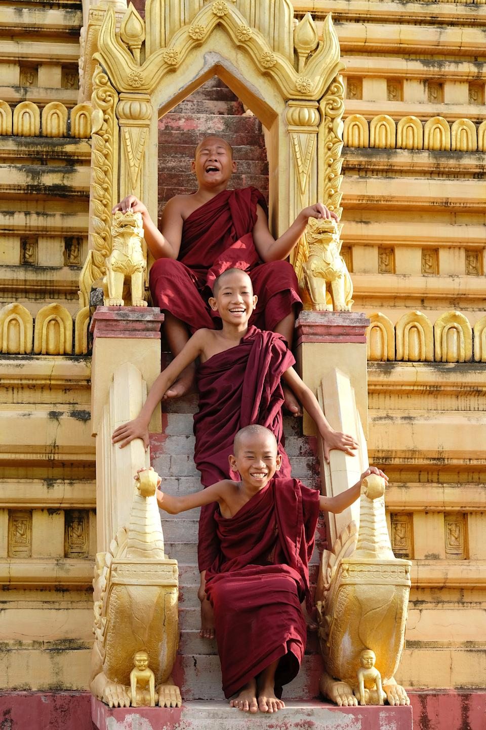 Three young Burmese monks are enjoying a break from their busy schedule in Indonesia. [Photo: SWNS]
