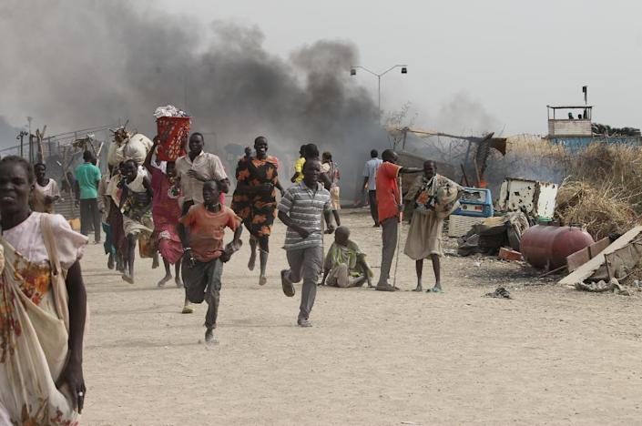 Civilians flee fighting in an UN base in the South Sudanese city of Malakal in February 2016, where gunmen opened fire on civilians sheltering inside (AFP Photo/Justin LYNCH)