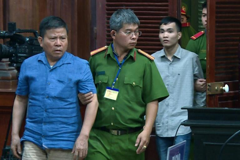 The Vietnam News Agency released a picture of  Australian citizen Chau Van Kham being escorted for trial in Ho Chi Minh City. He was jailed for 12 years on terrorism charges