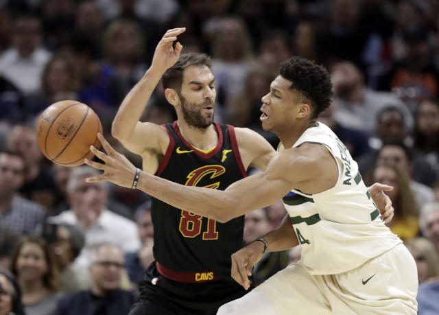 Milwaukee Bucks' Giannis Antetokounmpo (34), from Greece, passes around Cleveland Cavaliers' Jose Calderon (81), from Spain, in the first half of an NBA basketball game, Monday, March 19, 2018, in Cleveland. (AP Photo/Tony Dejak)