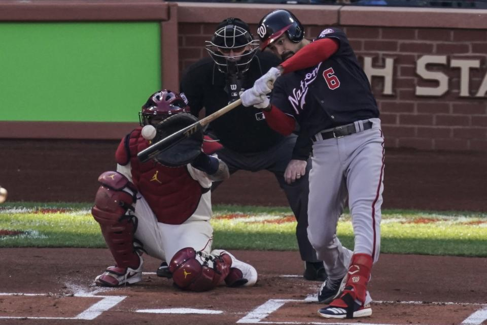 Washington Nationals' Anthony Rendon hits a single during the first inning of Game 2 of the baseball National League Championship Series against the St. Louis Cardinals Saturday, Oct. 12, 2019, in St. Louis. (AP Photo/Charlie Riedel)
