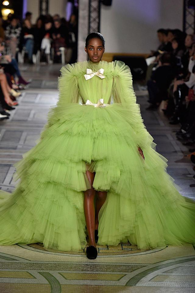 <p>Model wears a voluminous lime-green, multi-tier tulle gown from the Giambattista Valli SS18 Haute Couture show. (Photo: Getty Images) </p>