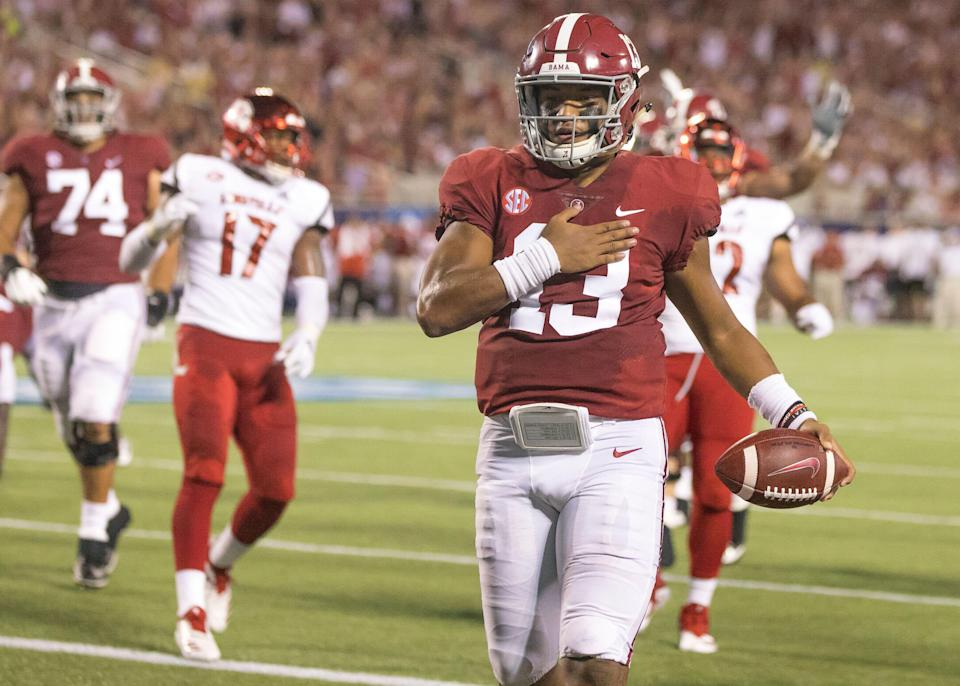 ORLANDO, FL - SEPTEMBER 01: Alabama Crimson Tide quarterback Tua Tagovailoa (13) celebrates a touchdown during the football game between the Alabama Crimson Tide and Louisville Cardinal in the Camping World Kickoff on September 1, 2018, at Camping World Stadium Orlando, FL. (Photo by Andrew Bershaw/Icon Sportswire via Getty Images)