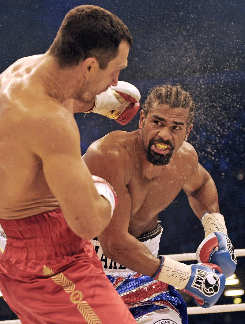 FILE - This is a Saturday, July 2, 2011 file photo of  David Haye of Britain, right. as he trades punches with Wladimir Klitschko of the Ukraine, during their  world heavyweight unification title bout in Hamburg, Germany. The British Boxing Board of Control said former WBA heavyweight champion David Haye does not want to renew his license to fight.  The British Boxing Board of Control general secretary Robert Smith told the BBC on Tuesday Oct. 11, 2011 that his organization has received confirmation in an email from Haye, who lost a heavyweight unification bout to Wladimir Klitschko in July. (AP Photo/Martin Meissner, File)