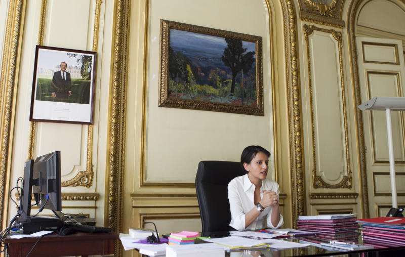 Najat Vallaud-Belkacem, French minister for Women's Rights, answers questions from the Associated Press in Paris, Tuesday, July 24, 2012. French lawmakers are nearing passage of a law on sexual harassment, more than two months after the country's previous one was thrown out by a court, and all pending cases along with it. (AP Photo/Jacques Brinon)