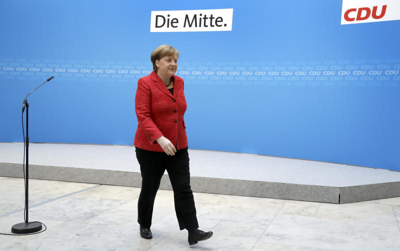 German Chancellor and chairwomen of the German Christian Democratic Union, Angela Merkel leaves after a statement at the party headquarters in Berlin Germany Monday
