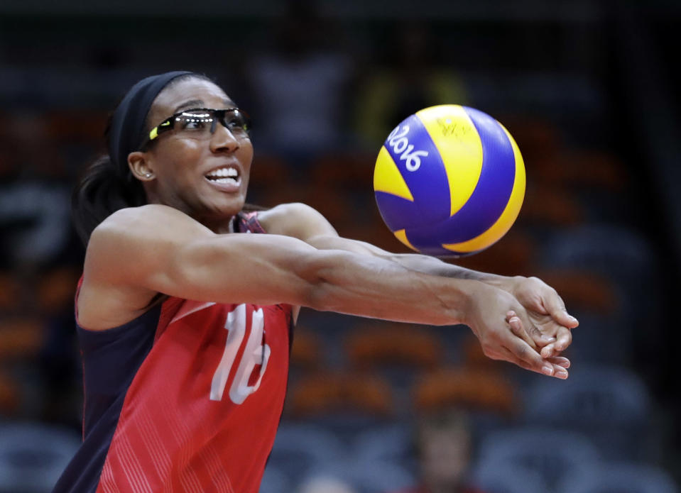 FILE - In this Aug. 12, 2016, file photo, United States' Foluke Akinradewo bumps during a women's preliminary volleyball match against Italy at the Summer Olympics in Rio de Janeiro, Brazil. Akinradewo Gunderson was initially skeptical of team building Zoom sessions that started during the pandemic but came to realize when the players got back together this spring that they had helped improve the relationships between the players. (AP Photo/Jeff Roberson, File)