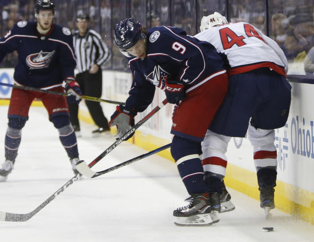 Columbus Blue Jackets' Artemi Panarin, left, of Russia, fights for position against Washington Capitals' Brooks Orpik during the second period of Game 6 of an NHL first-round hockey playoff series Monday, April 23, 2018, in Columbus, Ohio. (AP Photo/Jay LaPrete)