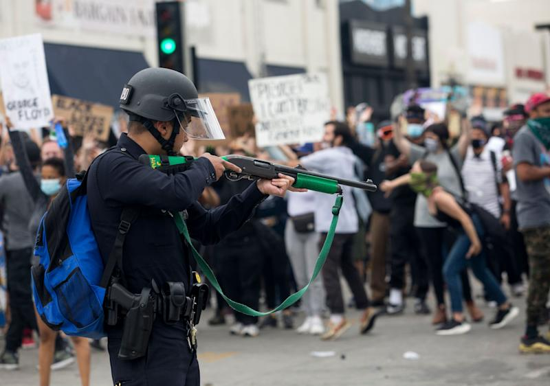 A police officer prepares to fire rubber bullets during a protest over the death of George Floyd, a handcuffed black man in police custody in Minneapolis, in Los Angeles on May 30, 2020.