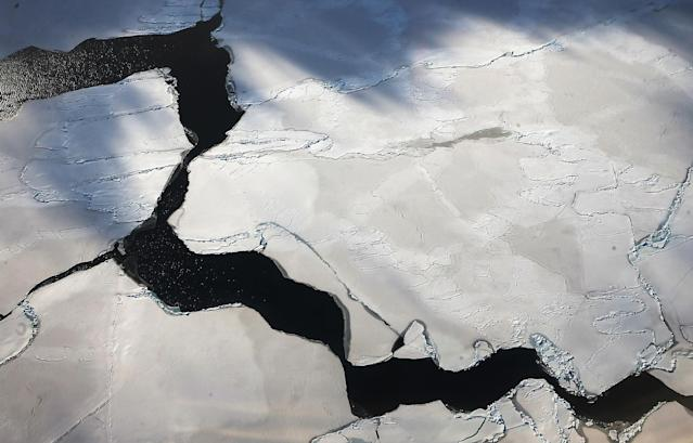 <p>Ice floats near the coast of West Antarctica viewed from a window of a NASA Operation IceBridge airplane on Oct. 27, 2016 in-flight over Antarctica. (Photo: Mario Tama/Getty Images) </p>