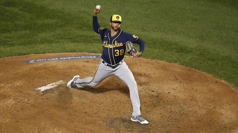 Milwaukee Brewers relief pitcher Devin Williams (38) delivers during a baseball game against the Chicago Cubs Friday, Aug. 14, 2020, in Chicago. (AP Photo/Jeff Haynes)