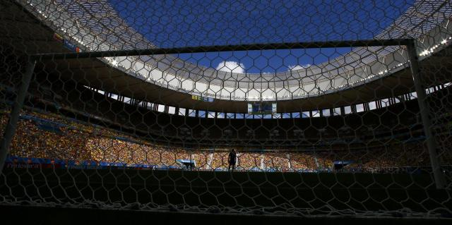 Colombia's goalkeeper David Ospina stands on the pitch during the 2014 World Cup Group C soccer match betweem Colombia and Ivory Coast at the Brasilia national stadium in Brasilia June 19, 2014. REUTERS/Paul Hanna (BRAZIL - Tags: SOCCER SPORT WORLD CUP TPX IMAGES OF THE DAY)