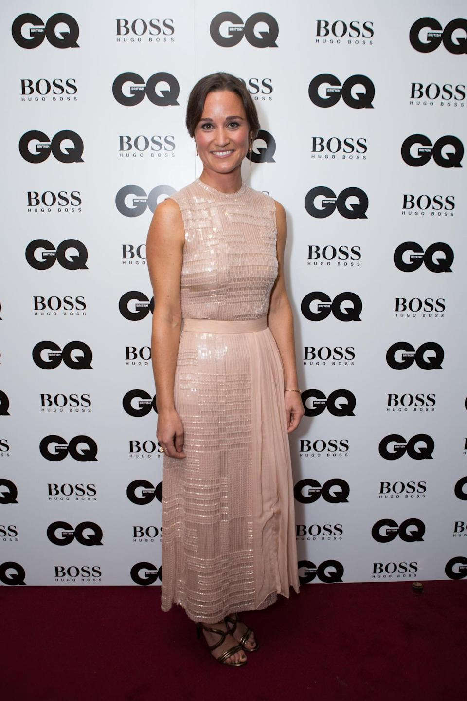 <p>Pippa got her glam on in a sequin encrusted Hugo Boss midi dress at the GQ Men of the Year awards in September 2014. <i>[Photo: PA Images]</i> </p>