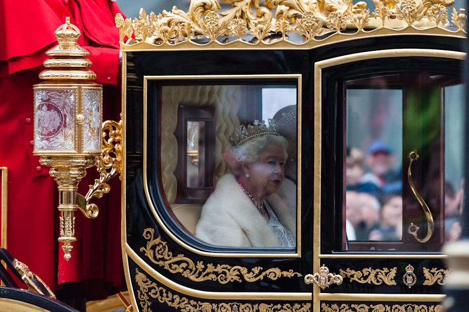 British Queen Elizabeth II travels in a horse-drawn state coach to the Houses of Parliament to deliver Queen's Speech during the State Opening of Parliament on 14 October, 2019 in London, England. (Photo by WIktor Szymanowicz/NurPhoto via Getty Images)
