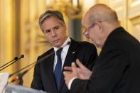 US Secretary of State Antony Blinken, left, listens as French Foreign Affairs Minister Jean-Yves Le Drian, right, speaks at a news conference at the French Ministry of Foreign Affairs in Paris, Friday, June 25, 2021. Blinken is on a week long trip in Europe traveling to Germany, France and Italy. (AP Photo/Andrew Harnik, Pool)