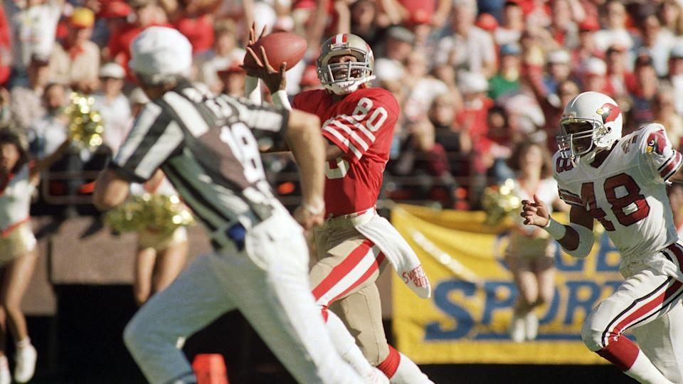 Mandatory Credit: Photo by Dan Murphy/AP/Shutterstock (6031892a)Jerry Rice San Francisco 49ers wide receiver Jerry Rice (80) pulls in a touchdown pass from quarterback Steve Young (not shows) as Los Angeles Rams safety Nolan Cromwell tries unsuccessfully to prevent the score in the first quarter of game on in San Francisco.