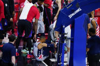 Philadelphia 76ers' Joel Embiid, left, checks on Washington Wizards' Russell Westbrook after an injury during the second half of Game 2 in a first-round NBA basketball playoff series, Wednesday, May 26, 2021, in Philadelphia. (AP Photo/Matt Slocum)