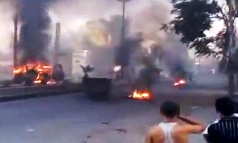 This image made from amateur video released by the Ugarit News and accessed Wednesday, July 18, 2012, purports to show burning tires in Damascus, Syria. Anti-regime activists say government forces are shelling a number of neighborhoods in and around the capital Damascus a day after a bomb killed three members of President Bashar Assad's inner circle. (AP Photo/Ugarit News via AP video) TV OUT, THE ASSOCIATED PRESS CANNOT INDEPENDENTLY VERIFY THE CONTENT, DATE, LOCATION OR AUTHENTICITY OF THIS MATERIAL