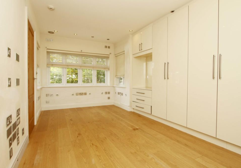 For sale home in Pinner, Greater London, with dozens of power sockets on walls inside.