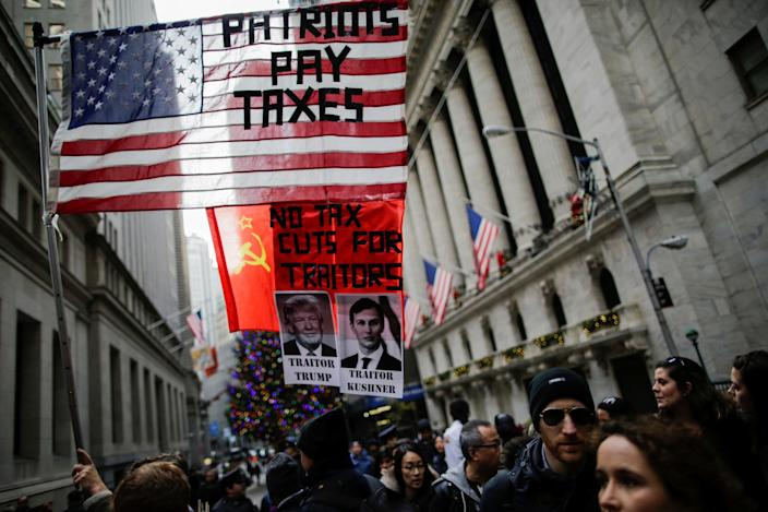 <p>Demonstrators take part in a protest against the U.S. government next to the New York Stock Exchange at the Manhattan borough in New York, Dec. 2, 2017. (Photo: Eduardo Munoz/Reuters) </p>