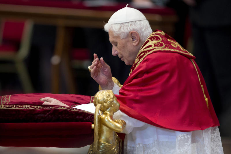 Pope Benedict XVI prays as he arrives inside St. Peter's Basilica at the Vatican to preside over a consistory, Saturday, Nov. 24, 2012. Six new cardinals are joining the elite club of churchmen who will elect the next pope, bringing a more geographically diverse mix into the European-dominated College of Cardinals. The new cardinals are: Archbishop James Harvey, the American prefect of the papal household; Abuja, Nigeria Archbishop John Olorunfemi Onaiyekan; Bogota, Colombia Archbishop Ruben Salazar Gomez; Manila, Philippines Archbishop Luis Antonio Tagle; Patriarch of Antioch of the Maronites in Lebanon, His Beatitude Bechara Boutros Rai; and the major Archbishop of the Trivandrum of the Siro-Malankaresi in India, His Beatitude Baselios Cleemis Thottunkal. (AP Photo/Andrew Medichini)