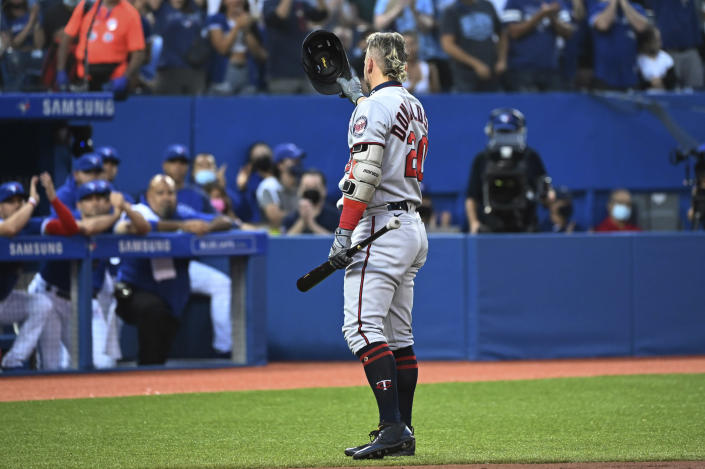Minnesota Twins' Josh Donaldson acknowledges the fans and the Toronto Blue Jays' dugout before his at-bat in the first inning of a baseball game Friday, Sept. 17, 2021, in Toronto. (Jon Blacker/The Canadian Press via AP)