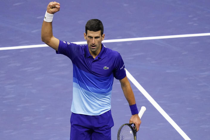 Novak Djokovic, of Serbia, reacts after winning the third set against Alexander Zverev, of Germany, during the semifinals of the US Open tennis championships, Friday, Sept. 10, 2021, in New York. (AP Photo/Seth Wenig)