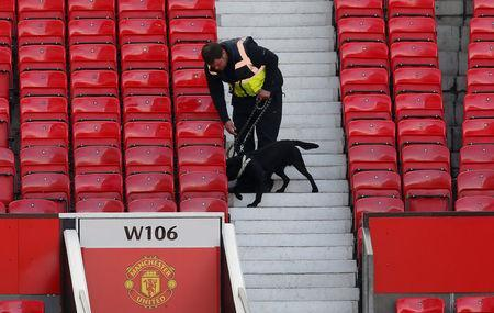 Britain Soccer Football - Manchester United v AFC Bournemouth - Barclays Premier League - Old Trafford - 15/5/16A police dog after the match was abandonedReuters / Andrew Yates