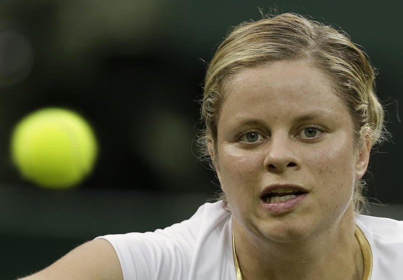 Kim Clijsters of Belgium returns a shot during a second round women's singles match against Andrea Hlavackova of Czech Republic  at the All England Lawn Tennis Championships at Wimbledon, England, Wednesday, June 27, 2012. (AP Photo/Kirsty Wigglesworth)