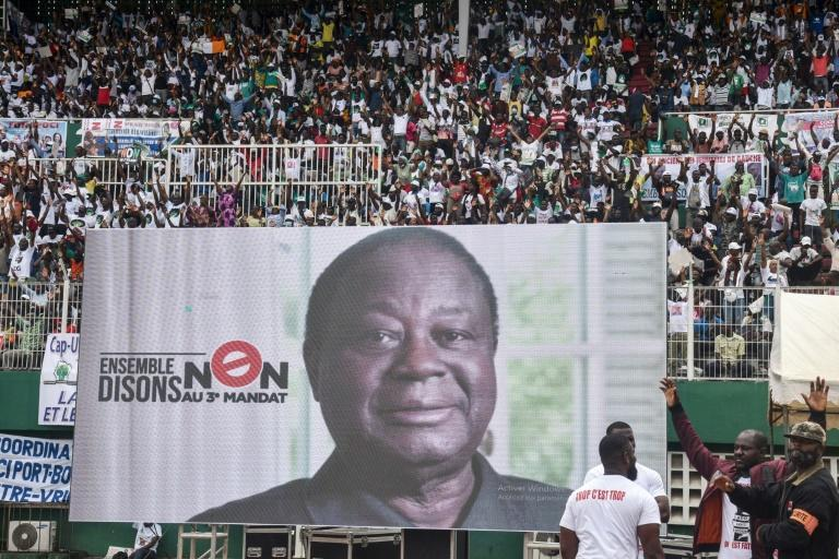 Bedie, seen here in a poster at an opposition rally, has called for civil disobedience against Ouattara's third term