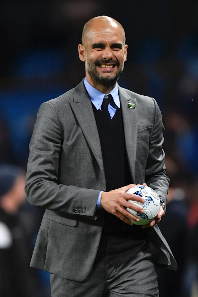 Manchester City's manager Pep Guardiola achieved his minimum objective of securing a place in next season's Champions League (AFP Photo/Anthony Devlin)