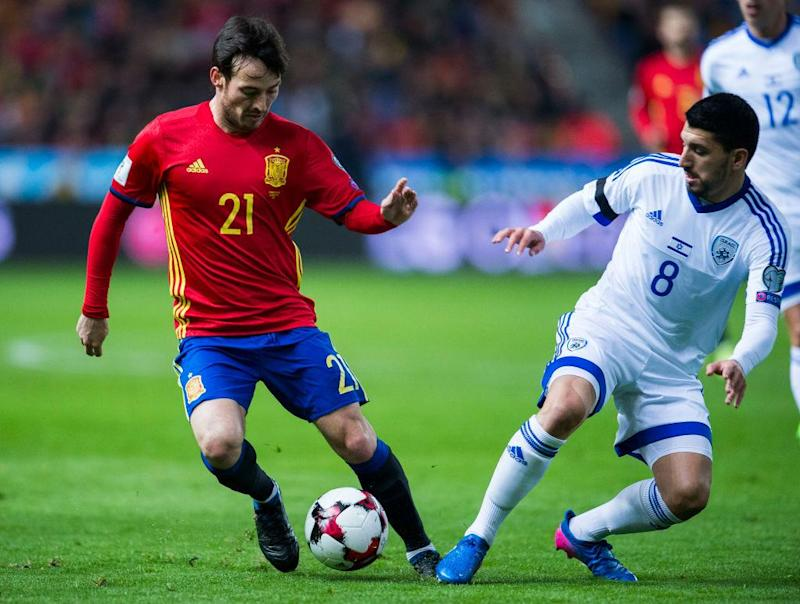 David Silva of Spain duels for the ball with Almog Cohen of Israel during the Fifa 2018 World Cup Qualifier between Spain and Israel at Estadio El Molinon on 24 March, 2017 in Gijon, Spain: Getty Images