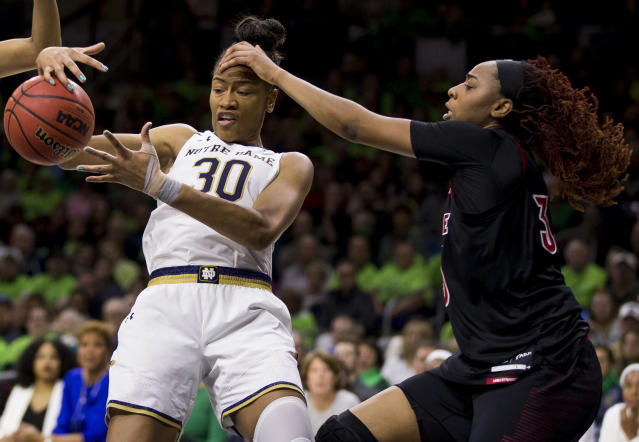Notre Dame's Mikayla Vaughn (30) gets fouled while competing for a rebound with Louisville's Bionca Dunham during the first half of an NCAA college basketball game Thursday, Jan. 10, 2019, in South Bend, Ind. (AP Photo/Robert Franklin)
