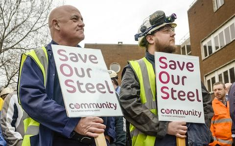 Workers stand with signs at Tata steel works on April 1, 2016 in Port Talbot, Wales. - Credit: Getty