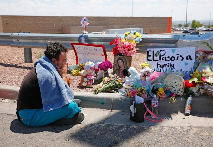 Felipe Avila mourns outside a Walmart in El Paso after a mass shooting on Aug. 4, 2019.