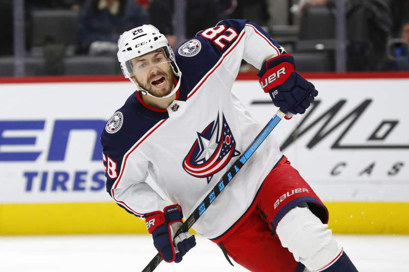 FILE - In this Dec. 17, 2019, file photo, Columbus Blue Jackets right wing Oliver Bjorkstrand plays against the Detroit Red Wings in the third period of an NHL hockey game in Detroit. Injuries to key players keep coming for the Columbus Blue Jackets, who now have lost top goal-scorer Oliver Bjorkstrand for the rest of the season. The 24-year-old forward fractured an ankle in Thursday night's, Feb. 20, 2020, loss to the Philadelphia Flyers. (AP Photo/Paul Sancya, File)