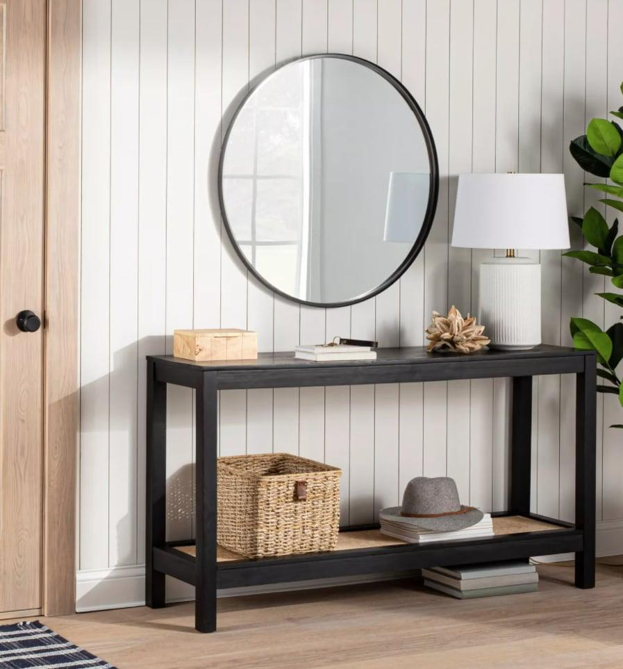 <p>The woven rattan shelf on this <span>Threshold Designed With Studio McGee Console Table </span> ($250) makes it look so expensive.</p>