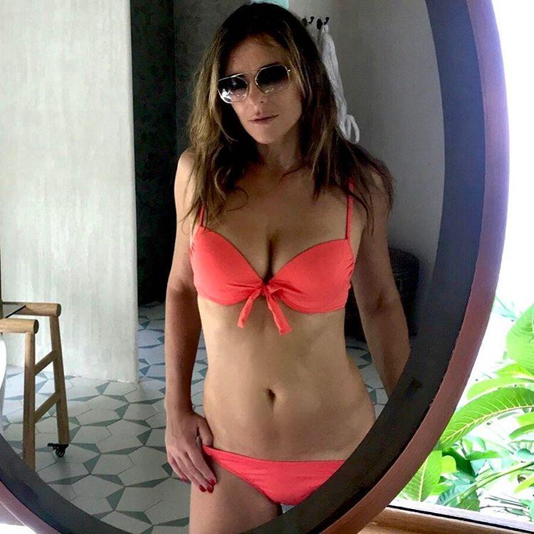 <p>Elizabeth Hurley is a swimwear designer and modelled one of her new creations in this peachy snap. Source: Instagram/Elizabeth Hurley </p>