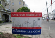 This July 8, 2021 photo shows a sign in Ocean City, N.J. urging opposition to offshore wind projects. (AP Photo/Wayne Parry)