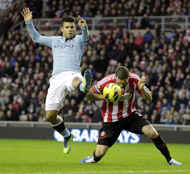 Sunderland's Carlos Cuellar (R) fights for the ball with Manchester City's Sergio Aguero during their English Premier League match at The Stadium of Light in Sunderland, north-east England, on December 26, 2012. Man City travel to Norwich next, while Sunderland host Tottenham, on Saturday
