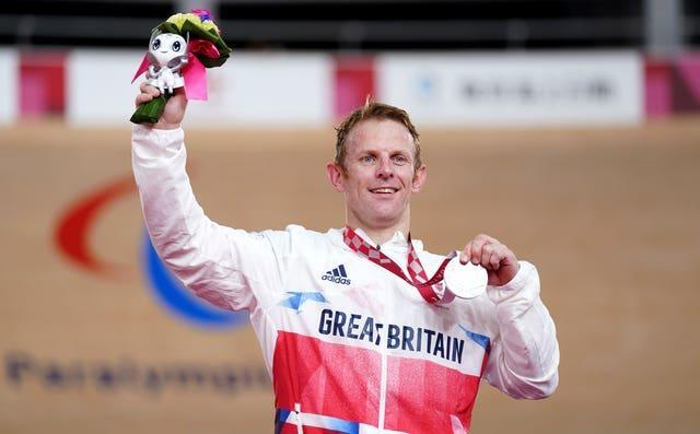 Jody Cundy celebrates on the podium with his silver medal following the men's C4/C5 1000m time trial