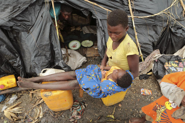 Survivors of Cyclone Idai in a makeshift shelter by the roadside near Nhamatanda about 50 kilometres from Beira, in Mozambique, Friday, March, 22, 2019. As flood waters began to recede in parts of Mozambique on Friday, fears rose that the death toll could soar as bodies are revealed. (AP Photo/Tsvangirayi Mukwazhi)