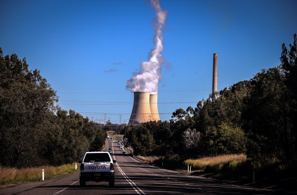 Smoke and steam rises from the Bayswater coal-powered thermal power station located near Muswellbrook, New South Wales, in Australia. Photo: David Gray/Getty Images