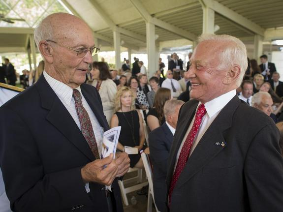 Apollo 11 Astronauts Michael Collins, left, and Buzz Aldrin talk at a private memorial service celebrating the life of Neil Armstrong, Aug. 31, 2012, at the Camargo Club in Cincinnati. Armstrong, the first man to walk on the moon during the 196