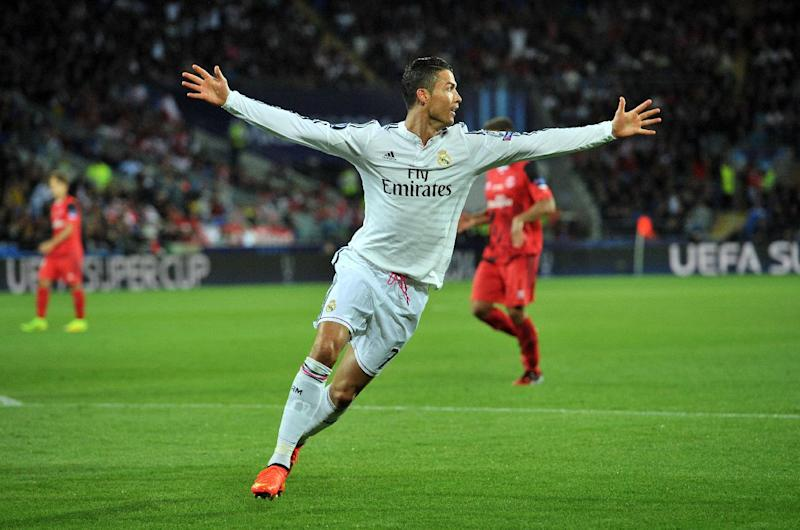 Real Madrid's Portuguese striker Cristiano Ronaldo celebrates scoring a goal during a match in Cardiff, south Wales on August 12, 2014