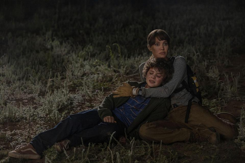 Connor (Finn Little) and Hannah (Angelina Jolie) take a breather after avoiding being roasted during a lightning storm.