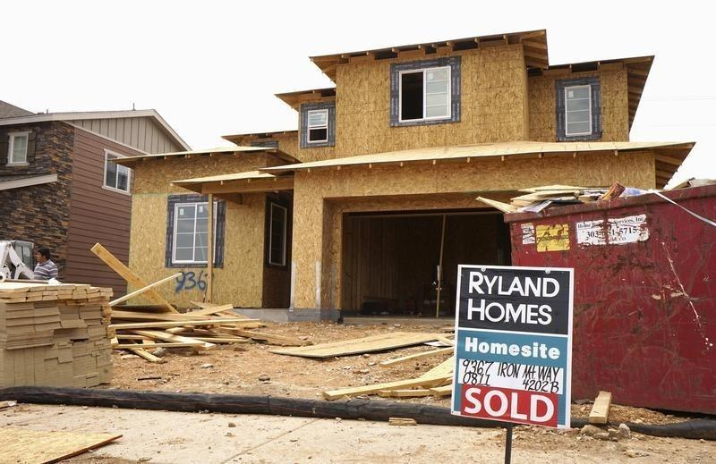 A house under construction has a sold sign out front in the Candelas development in the northwest Denver suburb of Arvada